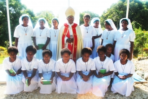 Archbishop Vunagi and the newly admitted sisters and novices