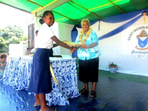 Mrs. Christina Vunagi presenting certificate to one of the student