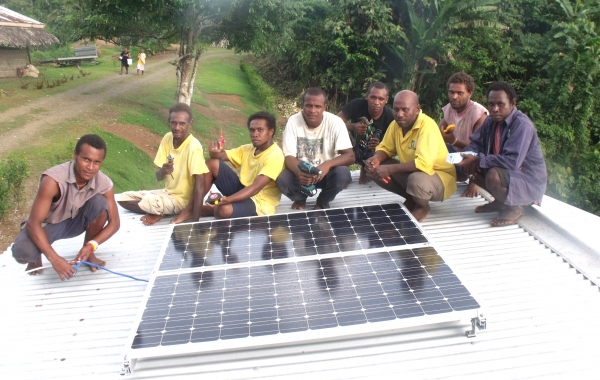Staff and students with newly installed Solar panel