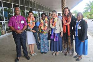 Archbishop Takeli (left) and Mrs June Takeli (right) pose for a photo with Mrs Caroline Welby and team upon arrival at the airport