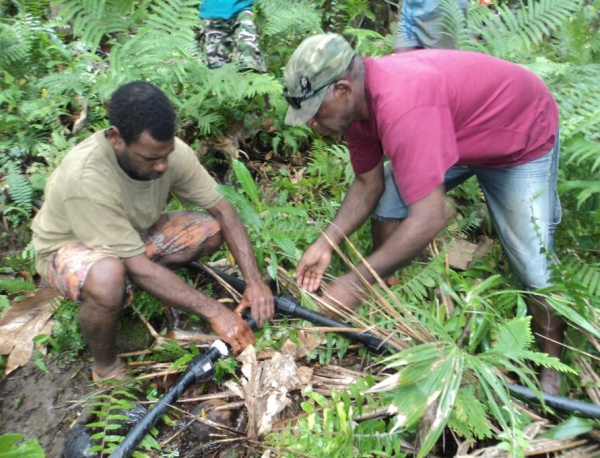 Two experts working on the water pipe project that supplies water into the village in the very remote communities in Northern Vanuatu.