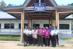 A group photo of Archbishop Takeli (third from right) and team with the Provincial Police Commandar (front left) infront of the Police station