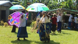 Mothers Union members of Chapuis Parish - Santo, DOVNC, dancing and displaying their gifts all the way from the mothers Union mem bers of St. Steven Taroaniara in the Diocese of Central Solomons - Solomon Islands. Below: Crews of MV Southern Cross sharing a time of joy together with MU and other members of Chapuis Parish after handing over the gifts.